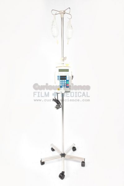 Infusion Pump Syringe Driver And Drip Bag On Stand