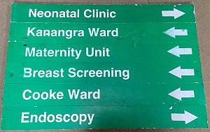 Green hospital sign