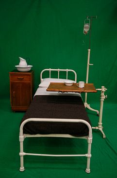 Period Bed with White Metal Frame