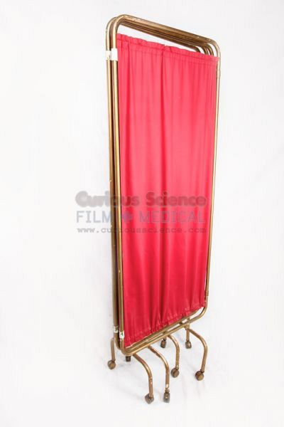 Hospital screen with red fabric