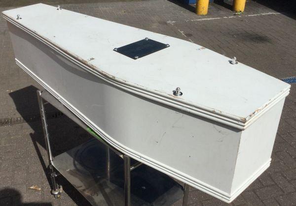 Plain white child's casket / coffin